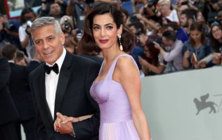 George Clooney says he gets up with Amal when she nurses the twins