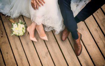 Bride's dream wedding photos 'ruined' by giant billboard