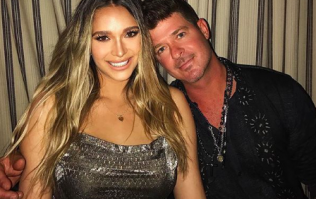 Robin Thicke's girlfriend April is being harshly criticised for sharing a breastfeeding photo