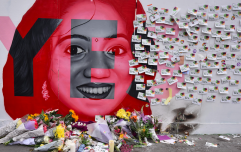 People are leaving flowers, tributes and messages at the mural of Savita in Dublin