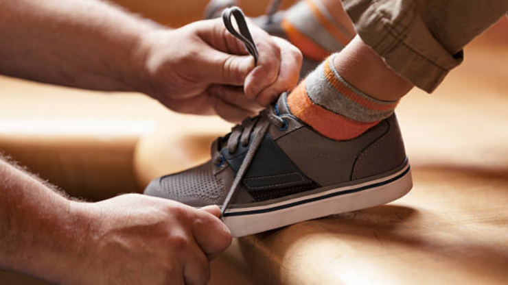 This little boy has super easy trick for tying his shoe laces that your kids should try