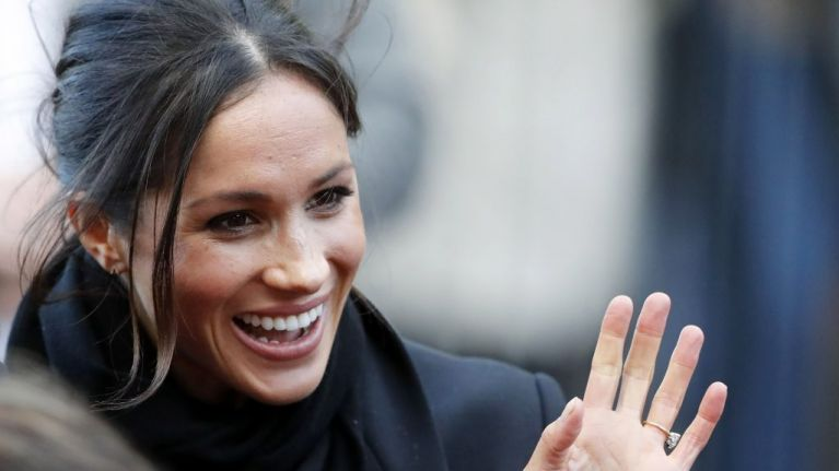 Meghan Markle has been spotted picking up her dog's poo outside Kensington Palace