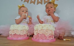 A baker made a life size cake of her twins for their birthday
