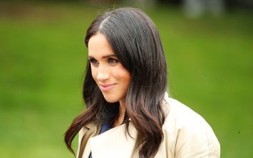 The Duchess of Sussex is absolutely glowing in royal blue designer dress
