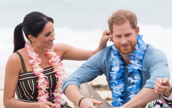 Meghan and Harry were very touchy-feely on Bondi Beach this morning