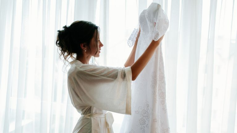 Bride upset after bridesmaid secretly posts photo from her wedding dress fitting on Facebook