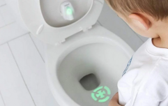 This bullseye toilet bowl light is teaching little boys to aim better when they pee
