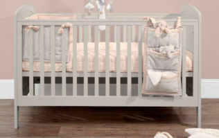 WIN a gorgeously cosy wood panelled cot and playmat bundle worth over €500