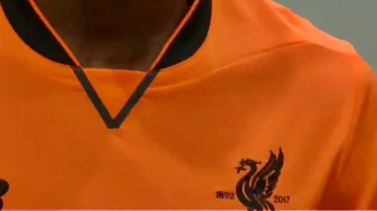 Liverpool have officially launched their new third kit, and it might just blind you