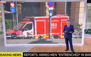 Spanish police say two armed suspects are 'entrenched' in bar following Barcelona terror attack