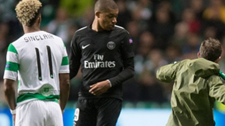 Celtic fan runs on the pitch and tries to kick Kylian Mbappe