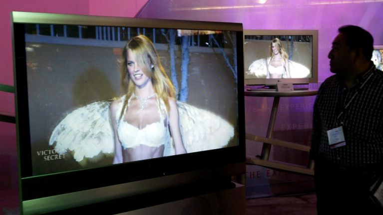 Victoria's Secret model goes flying on the catwalk but her trip has a happy ending