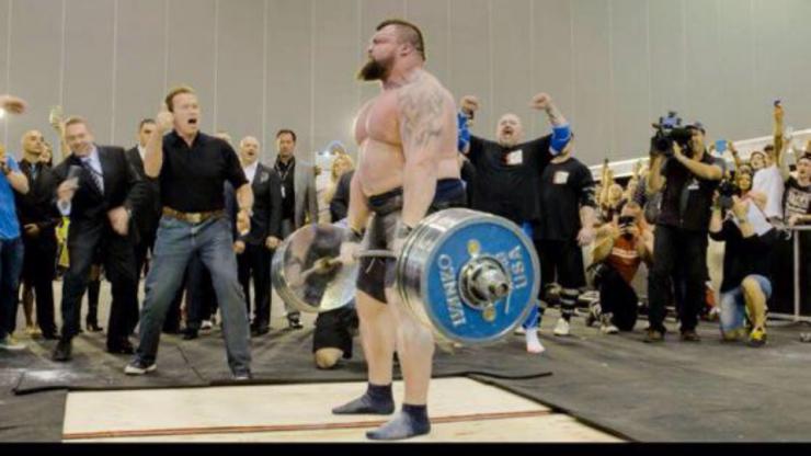 Oops! Strongman breaks deadlift record...then leaves Arnold Schwarzenegger hanging