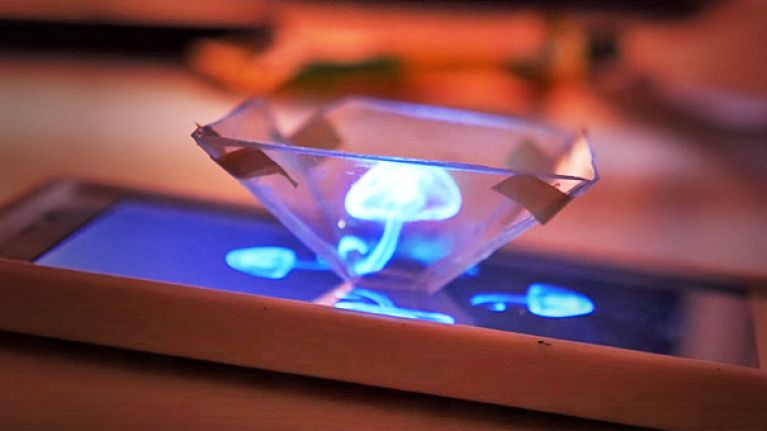 Turn your phone into a 3D hologram projector using tape and a CD
