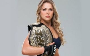 Ronda Rousey makes it onto the cover of a men's fitness cover for the first time ever (Pic)