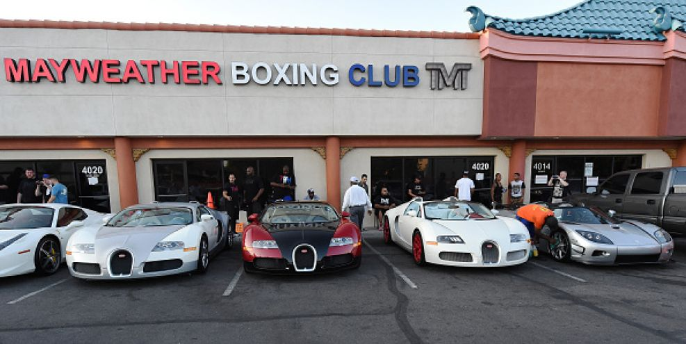 LAS VEGAS, NV - AUGUST 26:  Boxer Floyd Mayweather Jr.'s three Bugattis and his new USD 4.8 million Koenigsegg CCXR Trevita car (R) are parked outside the Mayweather Boxing Club during his media workout on August 26, 2015 in Las Vegas, Nevada. Mayweather will defend his WBC/WBA welterweight titles against Andre Berto on September 12 at MGM Grand in Las Vegas.  (Photo by Ethan Miller/Getty Images)