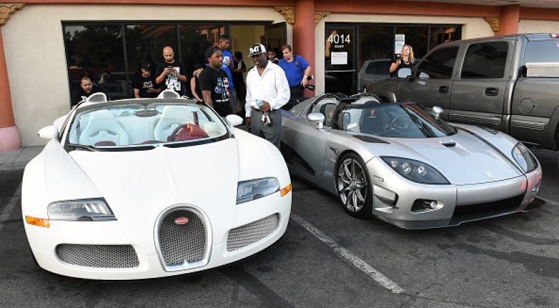 LAS VEGAS, NV - AUGUST 26:  One of boxer Floyd Mayweather Jr.'s Bugattis (L) and his new USD 4.8 million Koenigsegg CCXR Trevita car are parked outside the Mayweather Boxing Club during his media workout on August 26, 2015 in Las Vegas, Nevada. Mayweather will defend his WBC/WBA welterweight titles against Andre Berto on September 12 at MGM Grand in Las Vegas.  (Photo by Ethan Miller/Getty Images)