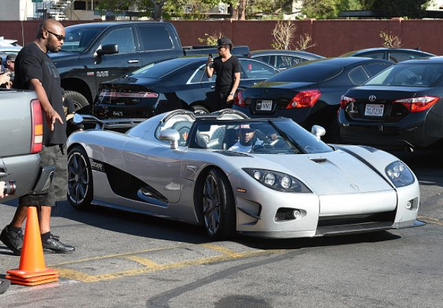 LAS VEGAS, NV - AUGUST 26:  Boxer Floyd Mayweather Jr. arrives at the Mayweather Boxing Club in his new USD 4.8 million Koenigsegg CCXR Trevita car for a media workout on August 26, 2015 in Las Vegas, Nevada. Mayweather will defend his WBC/WBA welterweight titles against Andre Berto on September 12 at MGM Grand in Las Vegas.  (Photo by Ethan Miller/Getty Images)
