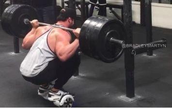 Bradley Martyn squats 140kg on a mini segway (Video)