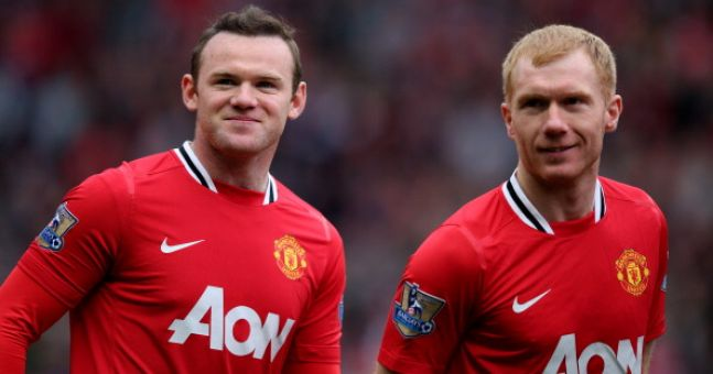 Paul Scholes defends Wayne Rooney's form, suggesting the problem lies elsewhere