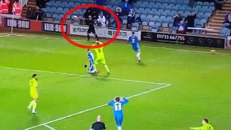 VIDEO: Confused linesman panics and gives all the possible decisions at once