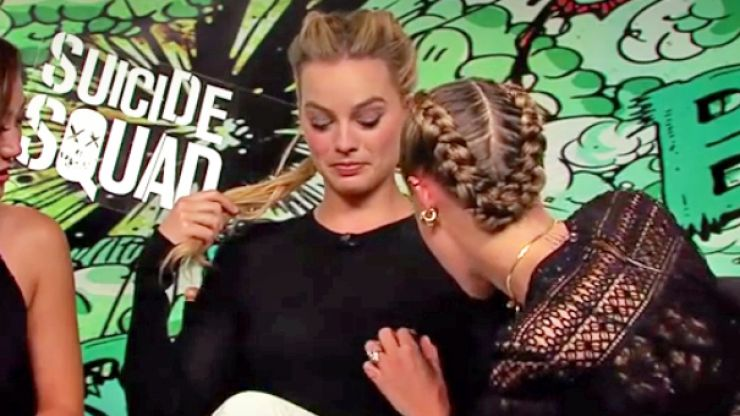 Cara Delevingne tries out her 'nipple detector' on Margot Robbie and we don't know what to think
