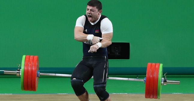 Olympic weightlifter snaps his arm in sickening lifting injury