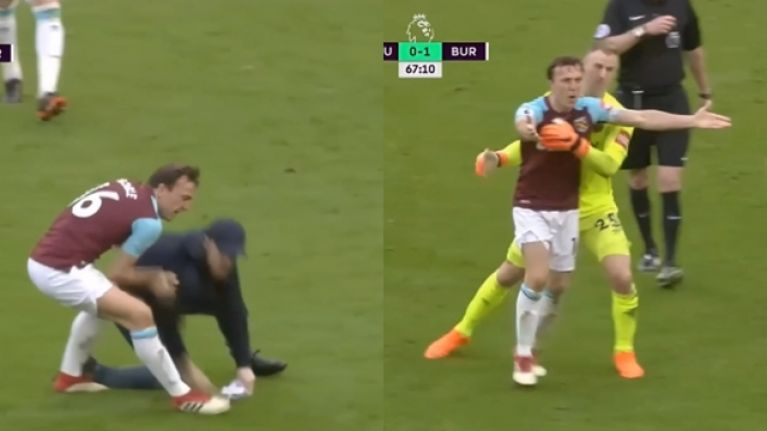 Mark Noble throws West Ham supporter to the ground during pitch invasion