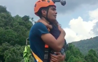 Dad faces serious backlash for bungee jumping with two-year-old daughter