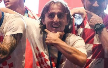 Luka Modrić invites disabled fan up on stage with him during World Cup celebrations