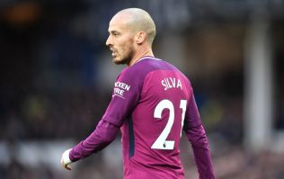 David Silva celebrates winning the title with his baby son