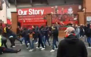 Roma supporters attack Liverpool fans outside Anfield prior to Champions League game