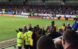 Bolton fans clash with one another and attempt to get at manager in ugly altercation