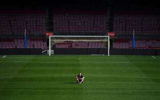 Andres Iniesta sits alone on the Camp Nou pitch until 1am following his final game for Barcelona