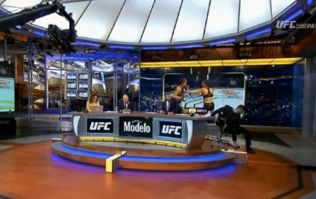 Michael Bisping avoids injury as he falls off chair while covering UFC Liverpool