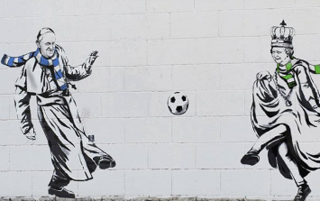 Graffiti outside Ibrox and Parkhead shows the Queen and the Pope playing football