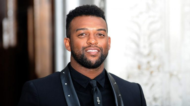JLS star Oritse Williams charged with raping a fan in a hotel room