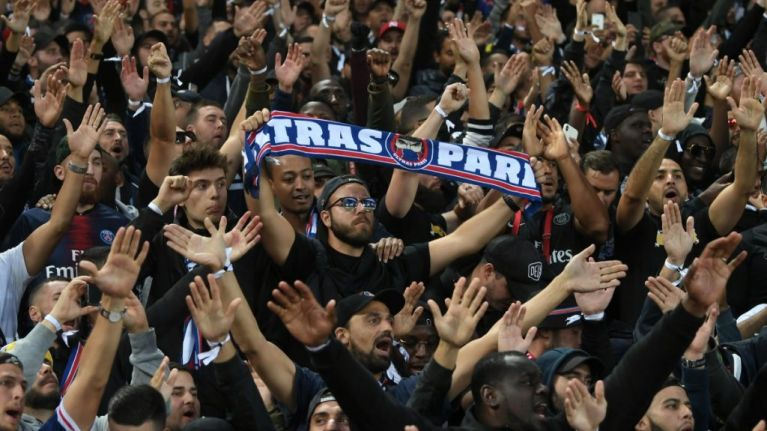PSG fans show support for Crystal Palace ultras at Anfield