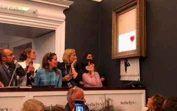 Banksy painting sold for $1.1 million at auction, immediately self-destructs