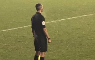 League Two assistant referee runs the line in smart shoes