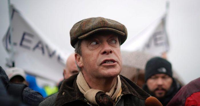 Nigel Farage trolled by billboard at Brexit march
