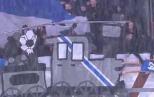 Genk fans hang plastic doll of former player from noose and run it over with cardboard train