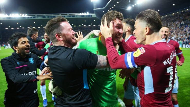 Villa goalkeeper Jed Steer stares down Mason Holgate before penalty save