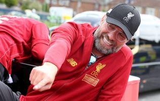 WATCH: Jurgen Klopp almost falls off bus during Liverpool's trophy parade