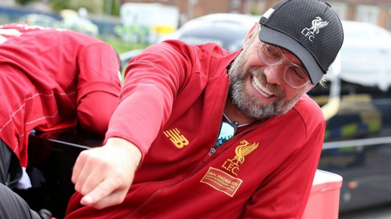 WATCH: Jurgen Klopp almost falls off bus during Liverpool's trophy parade