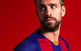 Barcelona unveil new checked home shirt