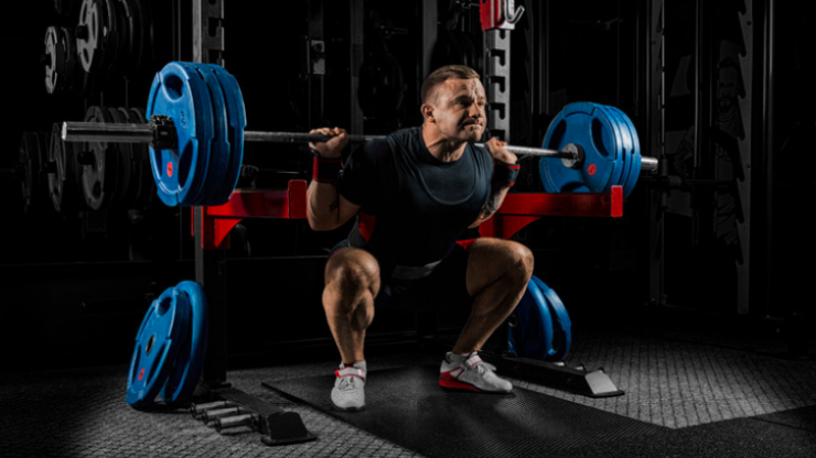 Why training like a powerlifter (not a bodybuilder) builds maximum muscle mass