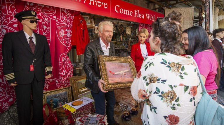 Come Flea With Me: Sir Richard Branson haggles flight prices in Tel Aviv market