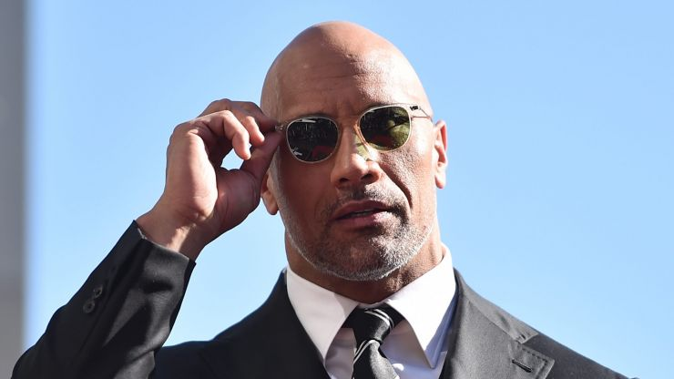 The Rock rips security gate off his wall after he gets trapped inside
