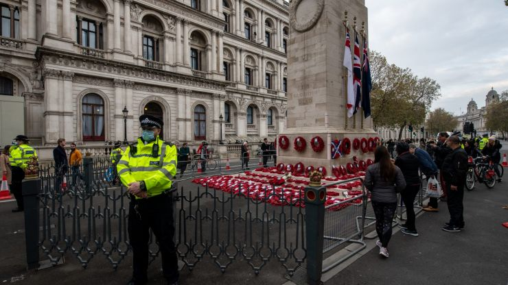 Extinction Rebellion place climate change banner on Cenotaph on Remembrance Day